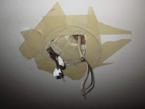 Tape around light fitting on ceiling