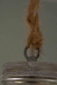 Braided twine covering the cord -- also, check out my faux zinc lid, achieved by wiping white paint on a plain jar cap