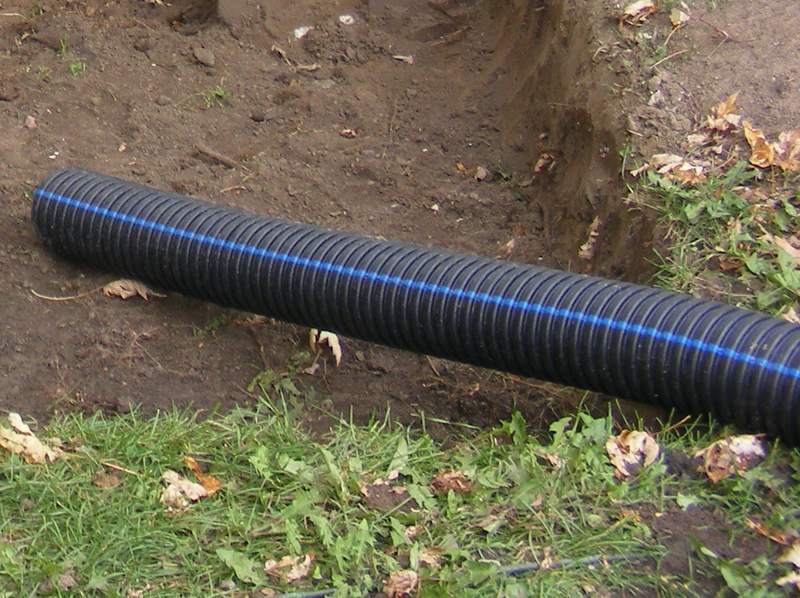 The plastic drain tile to connect the drains with the dry well.