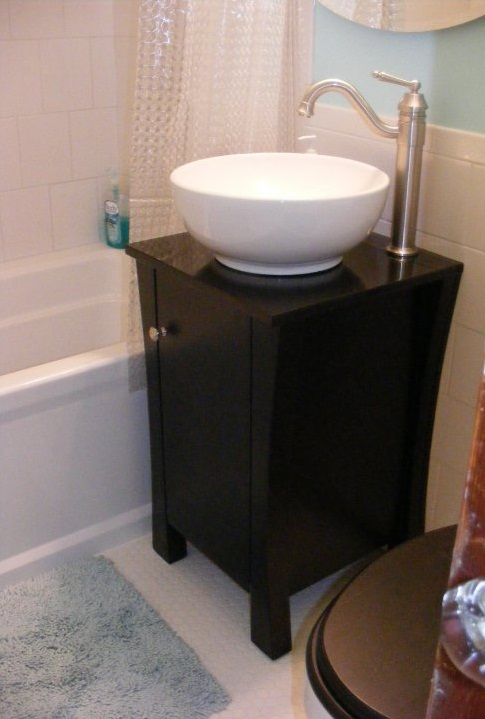 Vessel sink and vanity cabinet -- only 18 inches wide. It's a TINY bathroom.