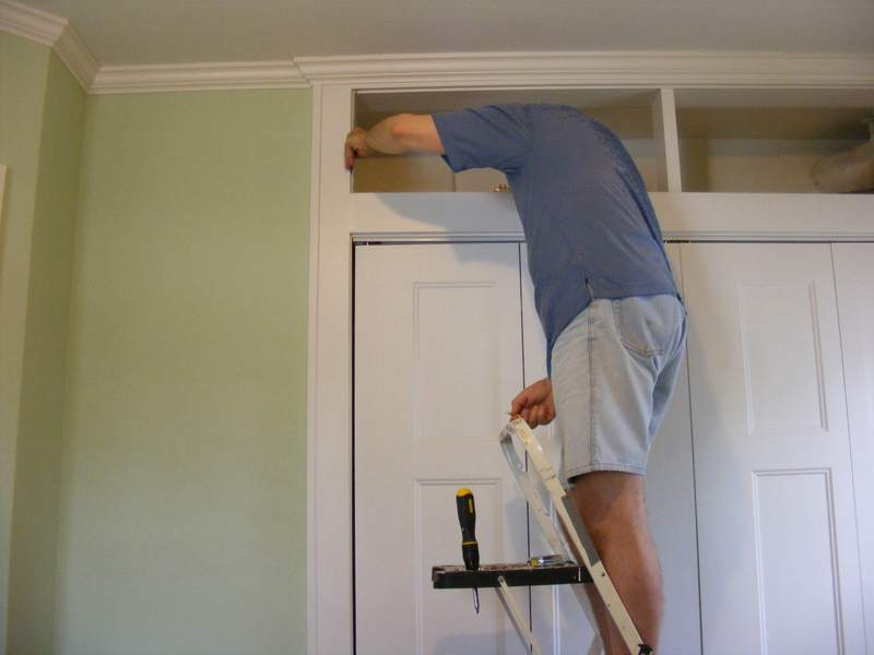 Fitting the closet doors.