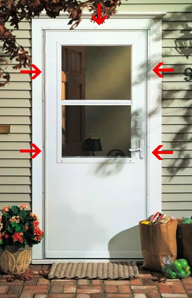 The strip around the edge is an angled frame that screws into and covers the edge of the door frame and contains the hinge, latch and weatherstripping. (via)