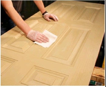 An unstained fiberglass door is a big slab of pastiness.