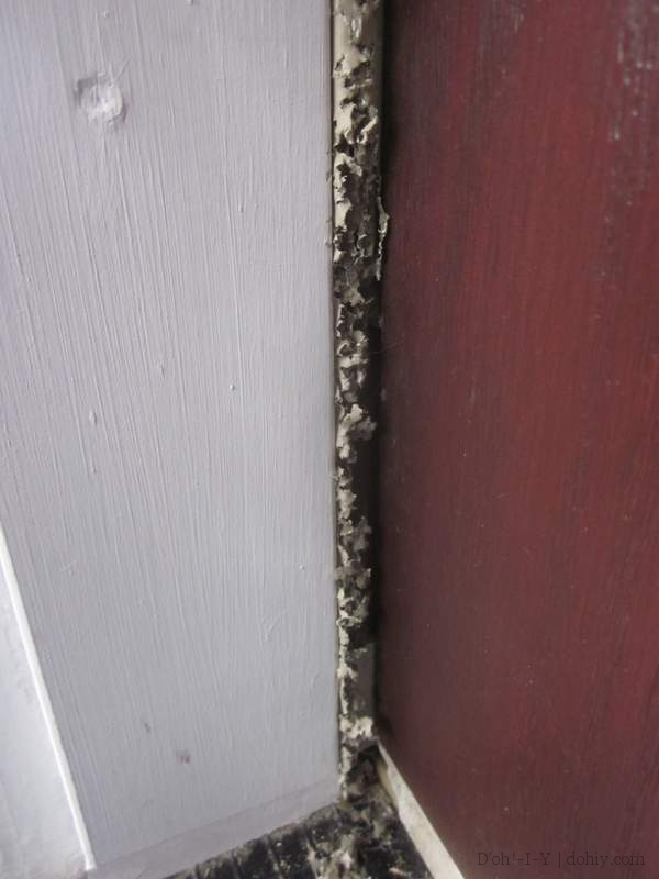Fitting nail on vinyl and sponge poly weatherstrip to a for Front door insulation