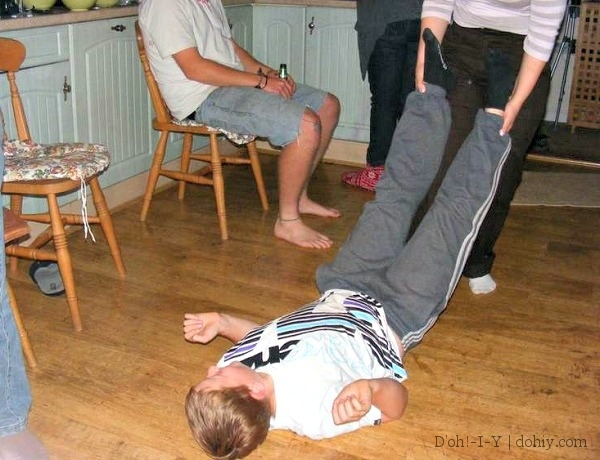 Me dragging nephew Charlie around the kitchen floor during a Pictionary tournament. I don't remember why, but he doesn't seem bothered by the development.
