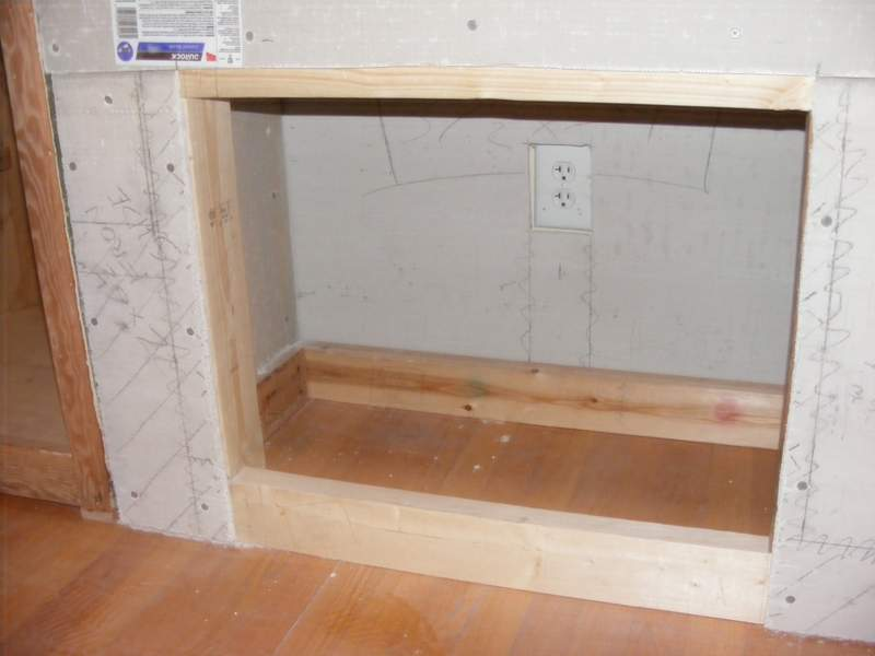 The enclosure for the fireplace.