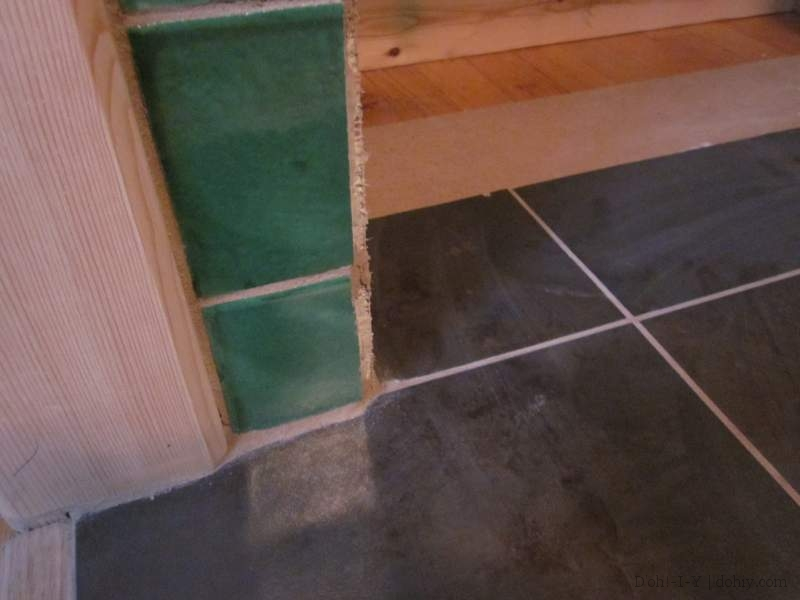 Hearth tiles stuck down to the hardboard and grouted.