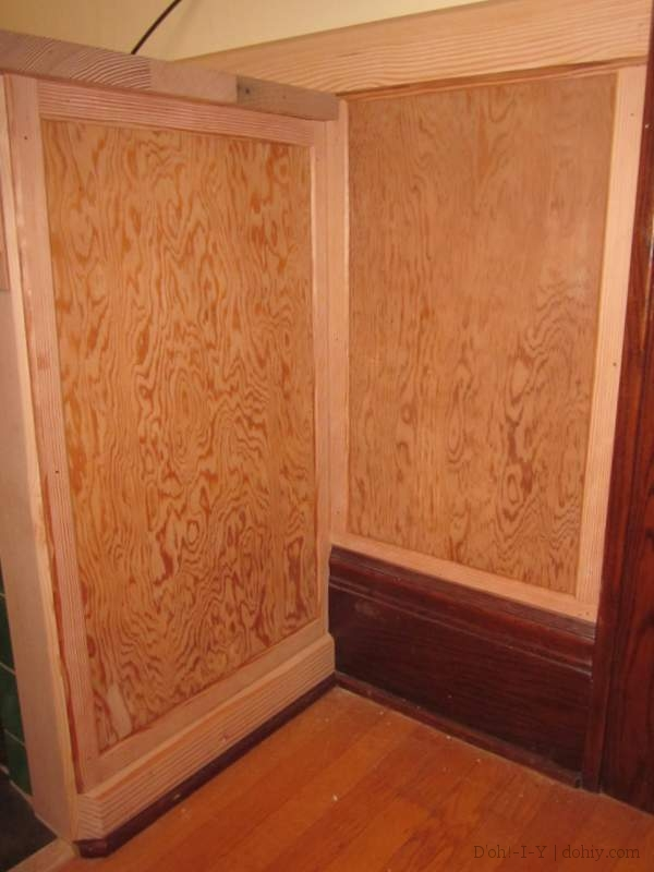 Paneling on the end of the built-in and on the wall.