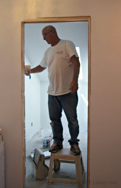 Dad priming the bathroom. Sis-in-law Mary was also on the scene.